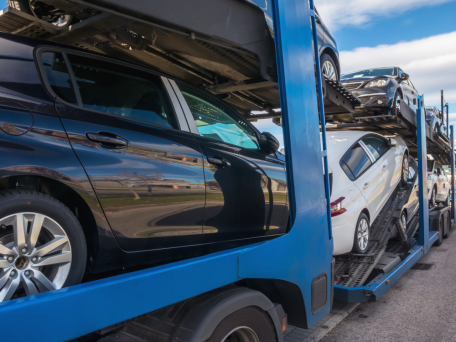 cars loaded on truck