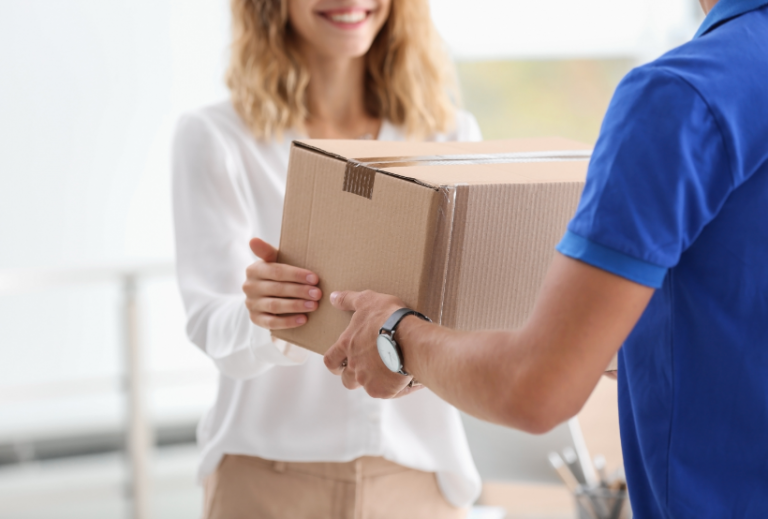 happy woman receiving a parcel