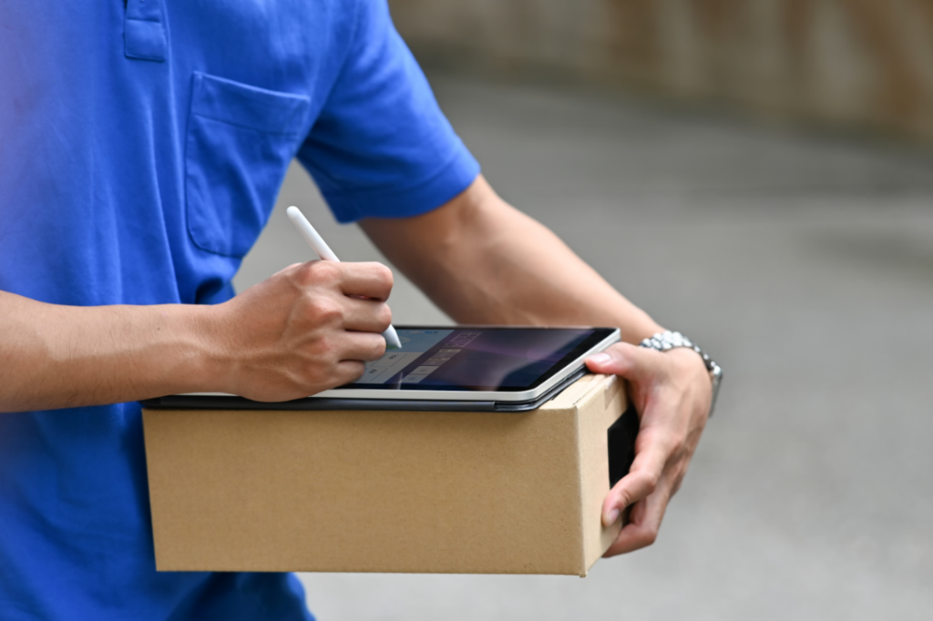 courier with a package and tablet