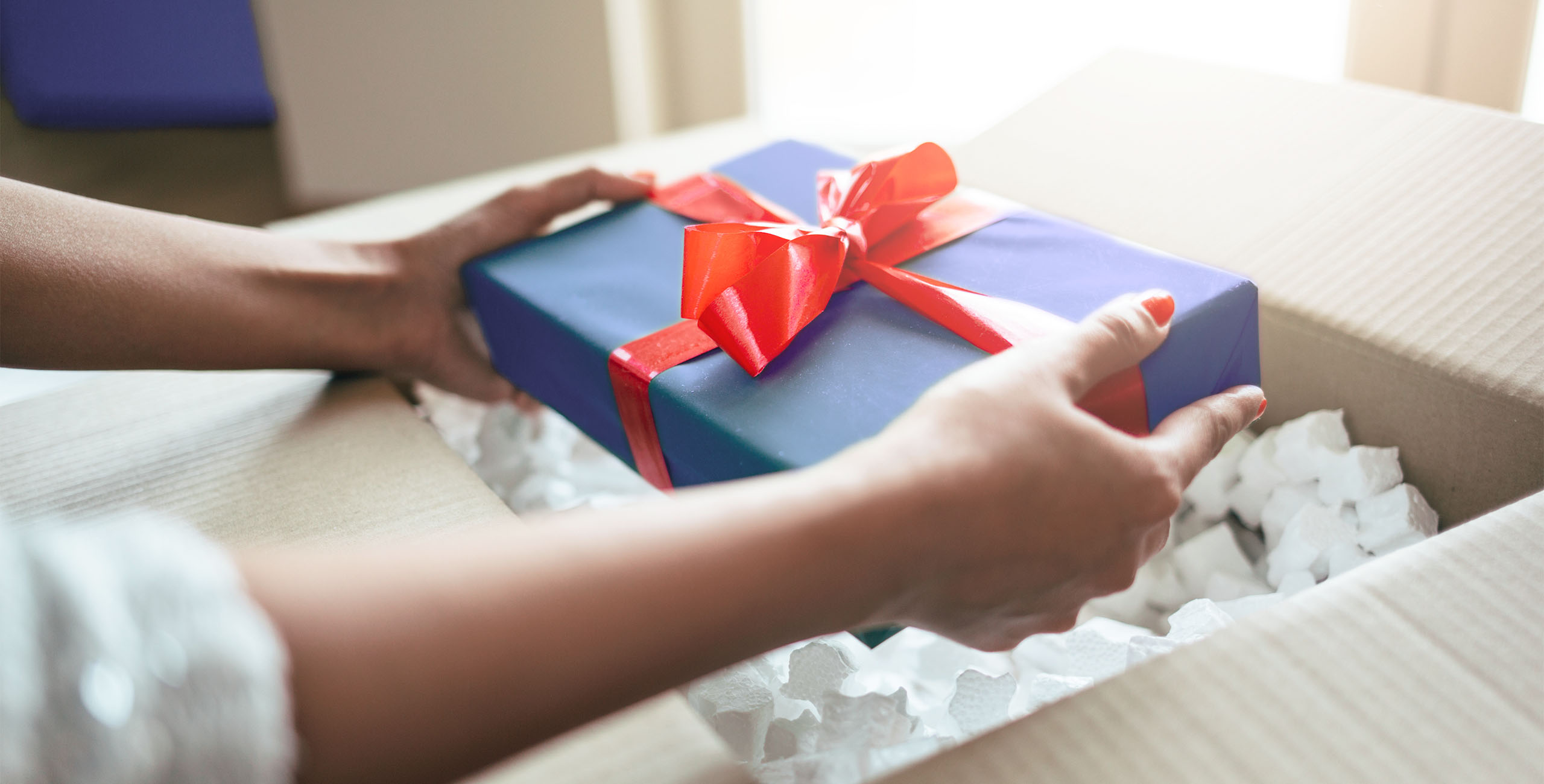 putting gift into a package